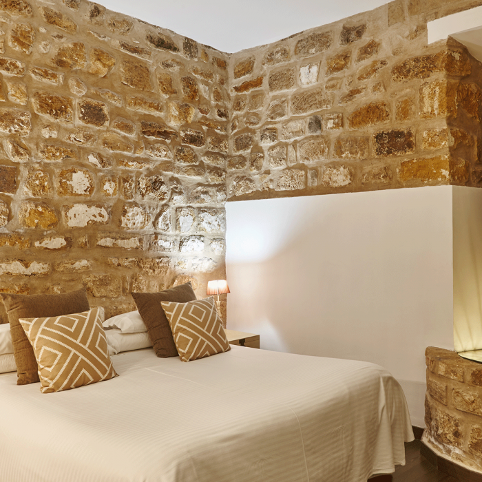 1_0004_bedroom-with-stone-walls-comfortable-modern-hotel-6TBGZCP